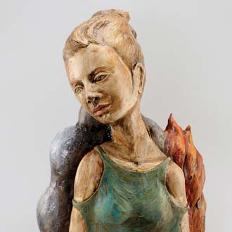 Photo of ceramic self-portrait by Cara Moczygemba